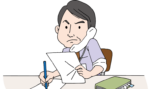 机に座って必死で書類を作成する大阪府の行政書士の男性画像